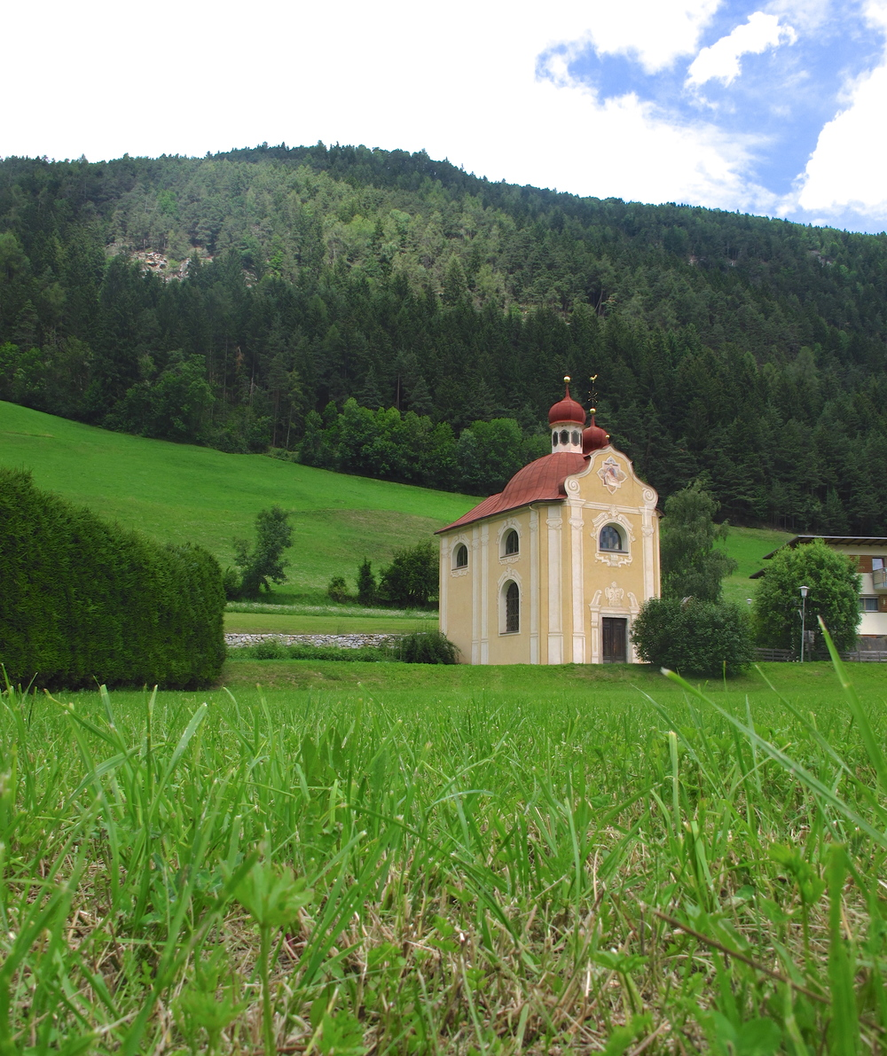 Small church in the midst of green hills