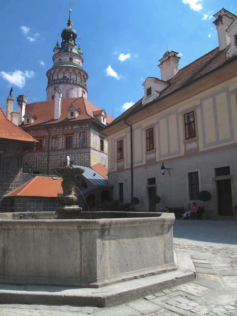 Cesky Krumlov castle square and tower - painted in many pastel colours.