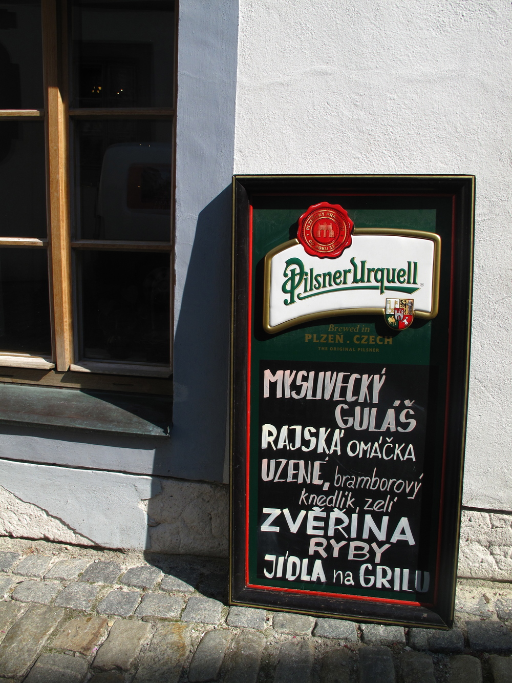 Pilsner Urquell pub sign in Cesky Krumlov, Czech Republic