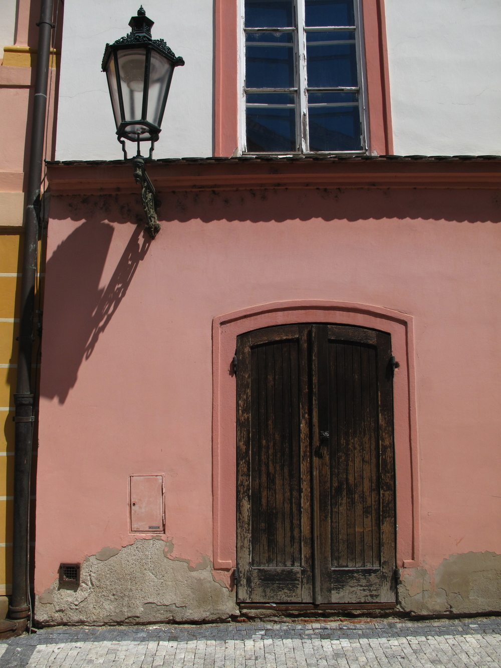 Textures of Prague, old houses, street lamps, and pink walls.