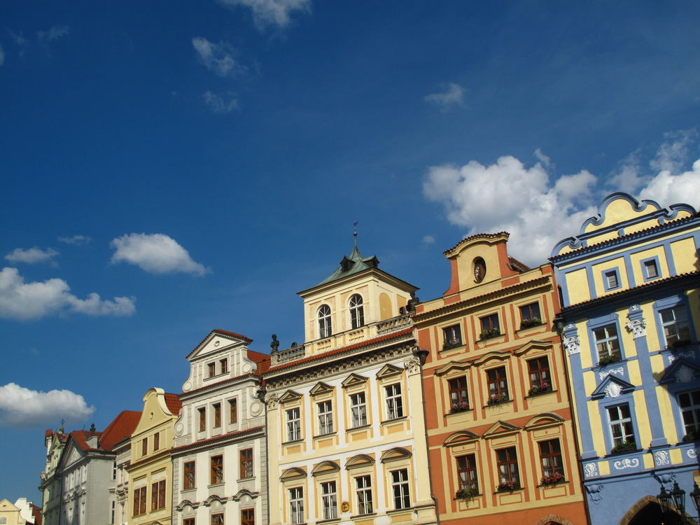 Old Town Square, Prague - colourful buildings and parapets.