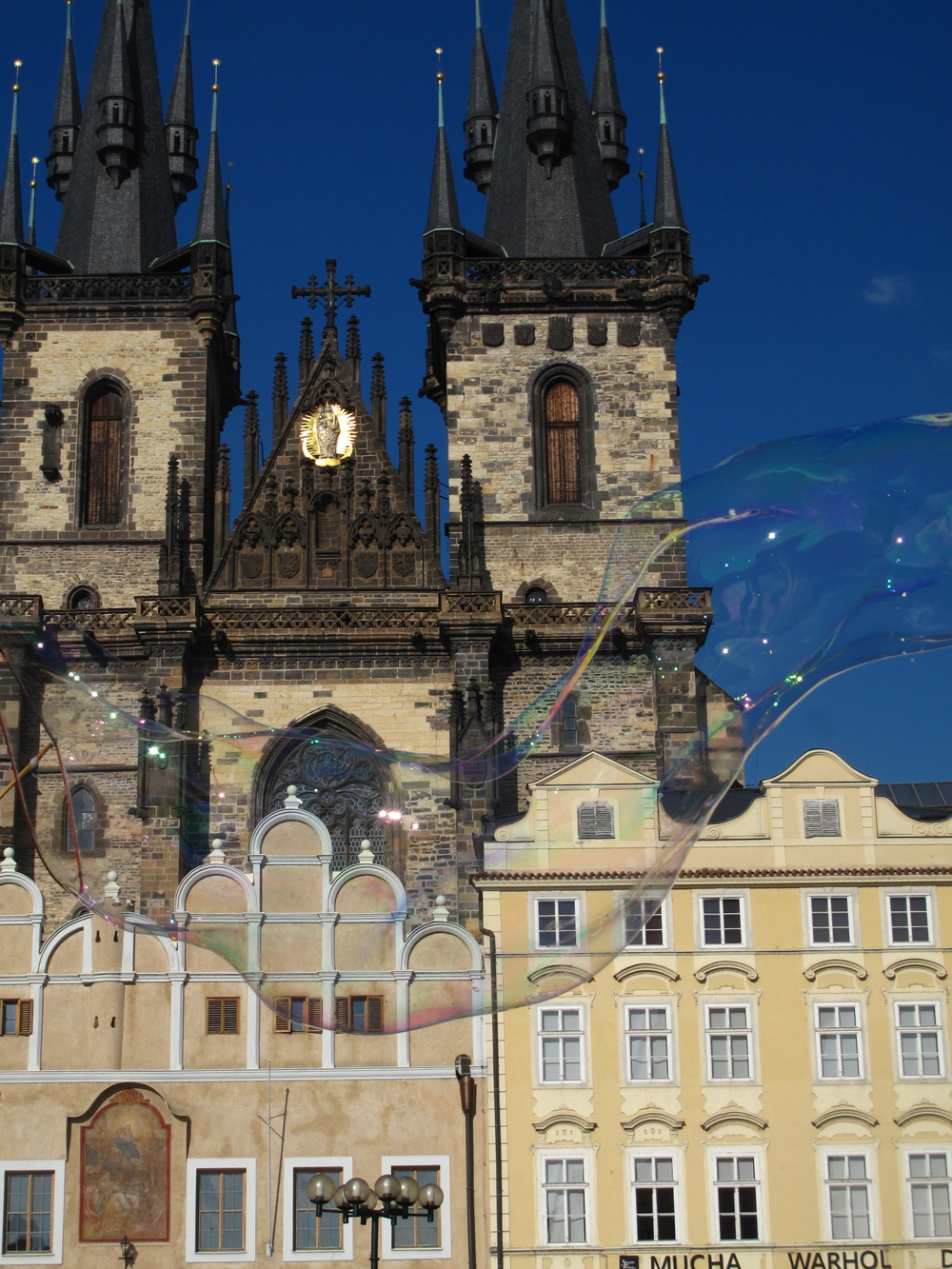 Blowing giant bubbles in the Old Town Square of Prague.