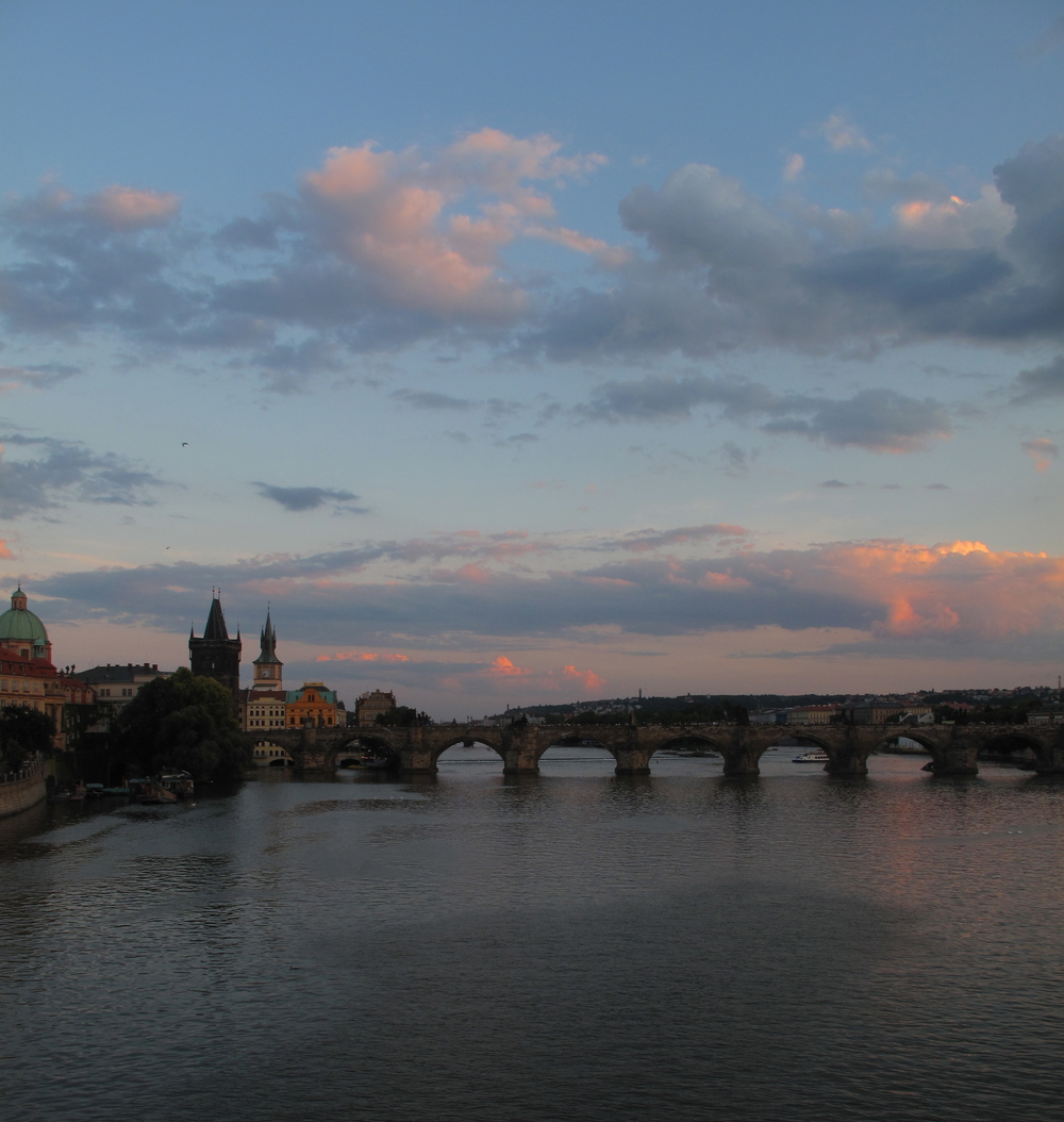 Prague river and Karlov Most - Charles Bridge at sunset.