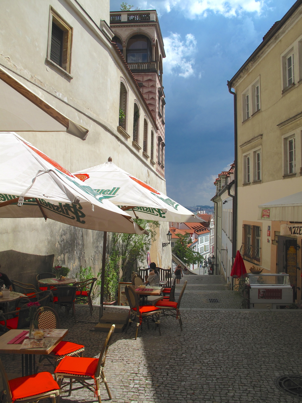 Cafe seats out in the narrow lanes of Prague