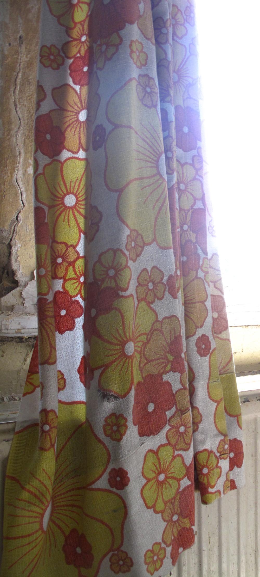 Curtains fluttering in the wind - with a 60's orange flower pattern, Elisabeth Sanatorium