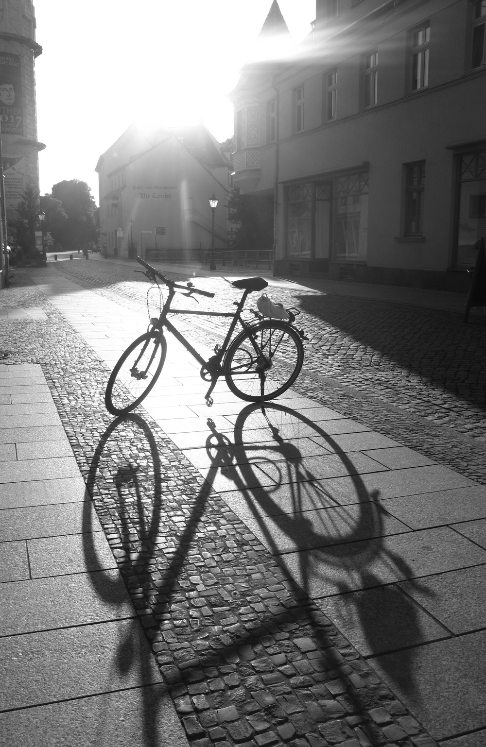 Bicycle and long shadows of the bicycle in the afternoon, Wittenberg.