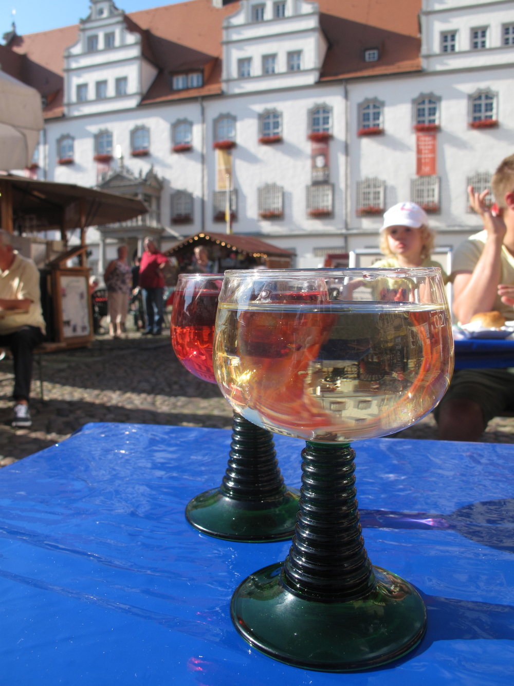 Drinking local German sweet wines at the Weinfest in Wittenberg.