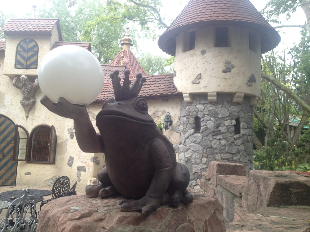 Sleeping Beauty's castle - frog holding a crystal ball at the gates.
