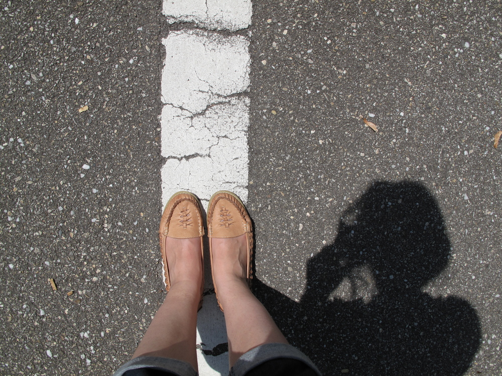 Walking on the white line.