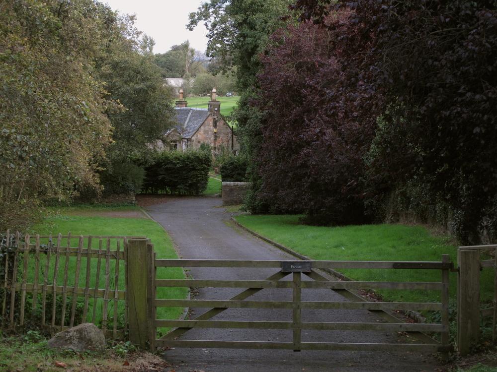 Duddingston cottage among trees.