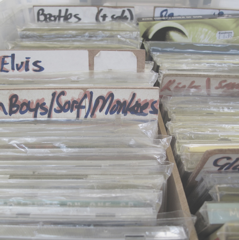 Stacks of second hand CDs and tapes at the Stockbridge market, Edinburgh.