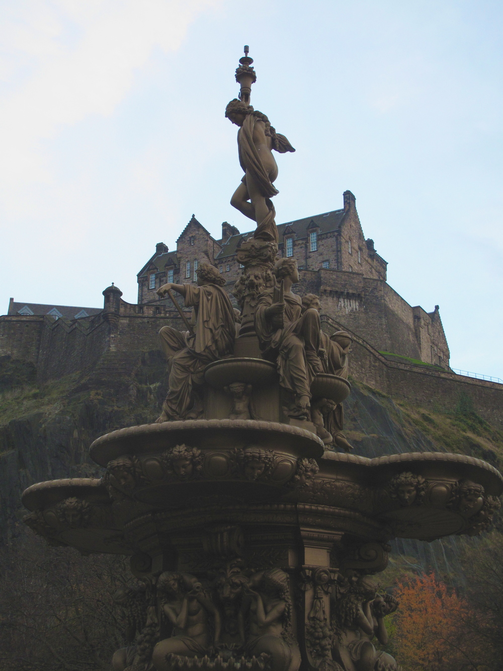 Fountain in the Princes Street Gardens, Edinburgh Castle in the background.