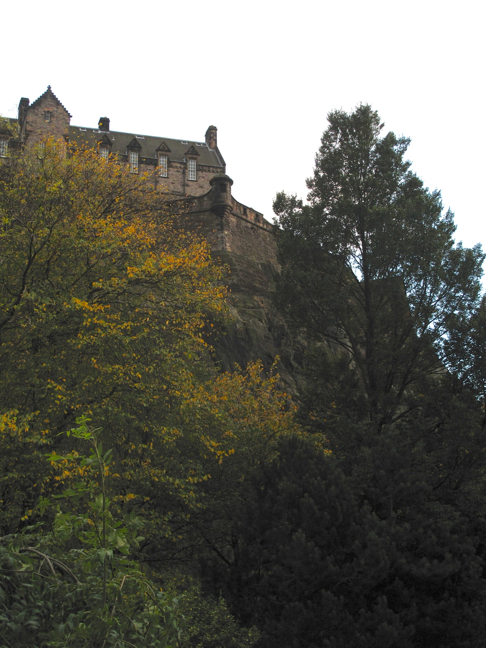 Edinburgh Castle seen from Princes Street Gardens - at dusk in autumn.
