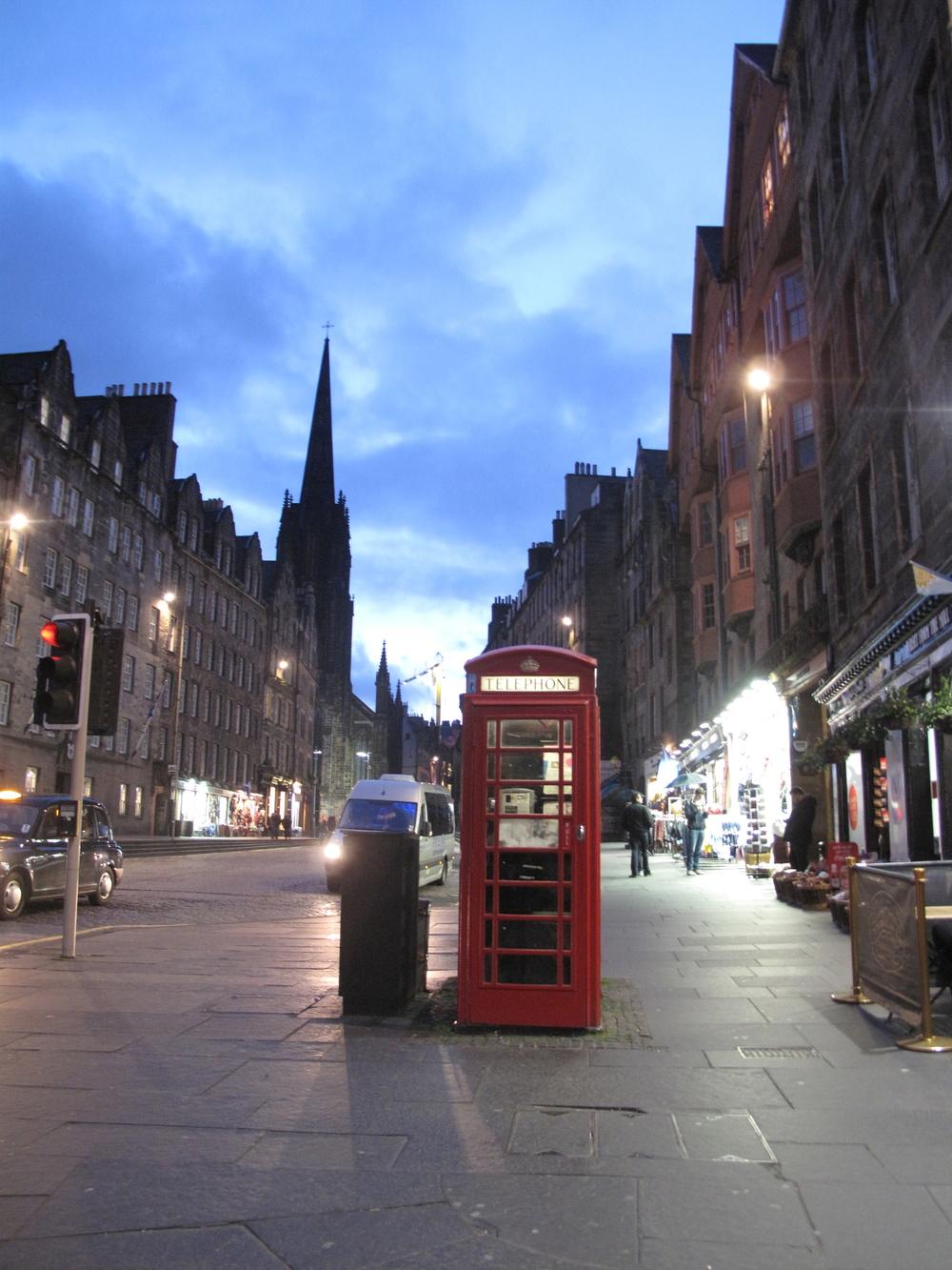 Red telephone box on the Royal Mile at dusk, Edinburgh.