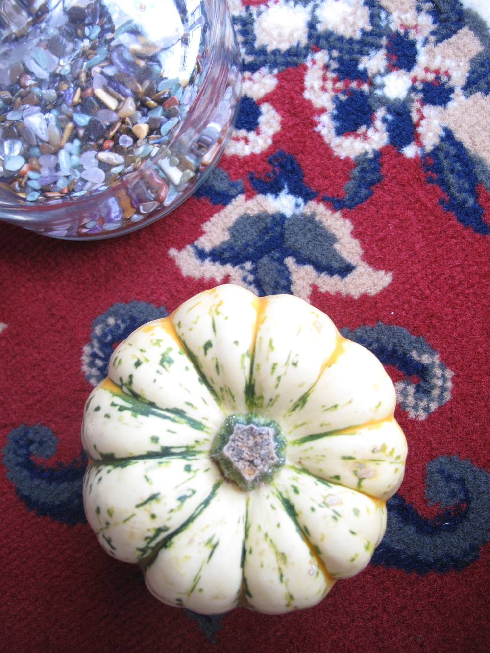 Pumpkin and patterned carpet.