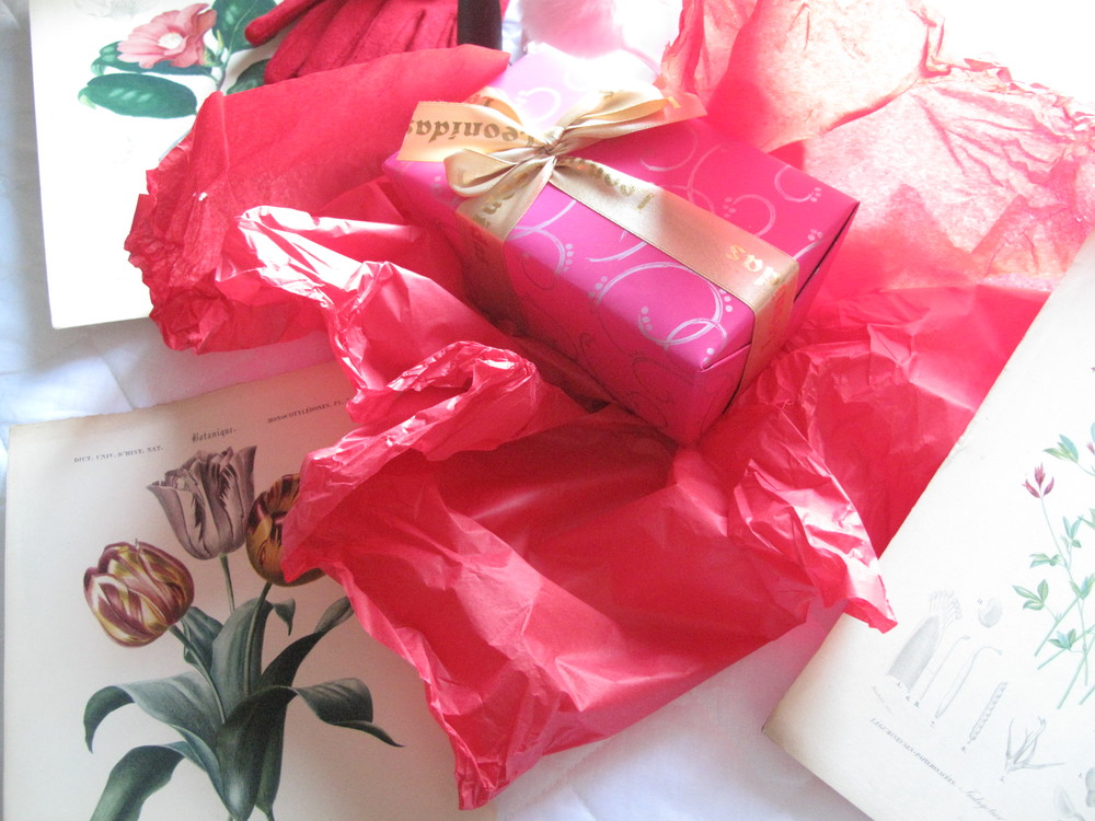 Leonida chocolates in pink wrapping with other luxuries.