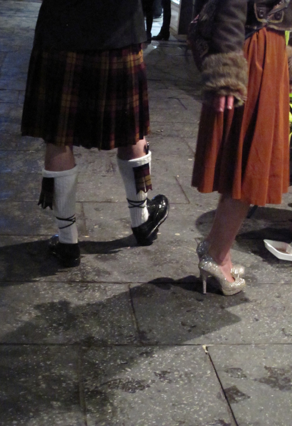 Kilts and dresses at a ceilidh on St Andrew's day.