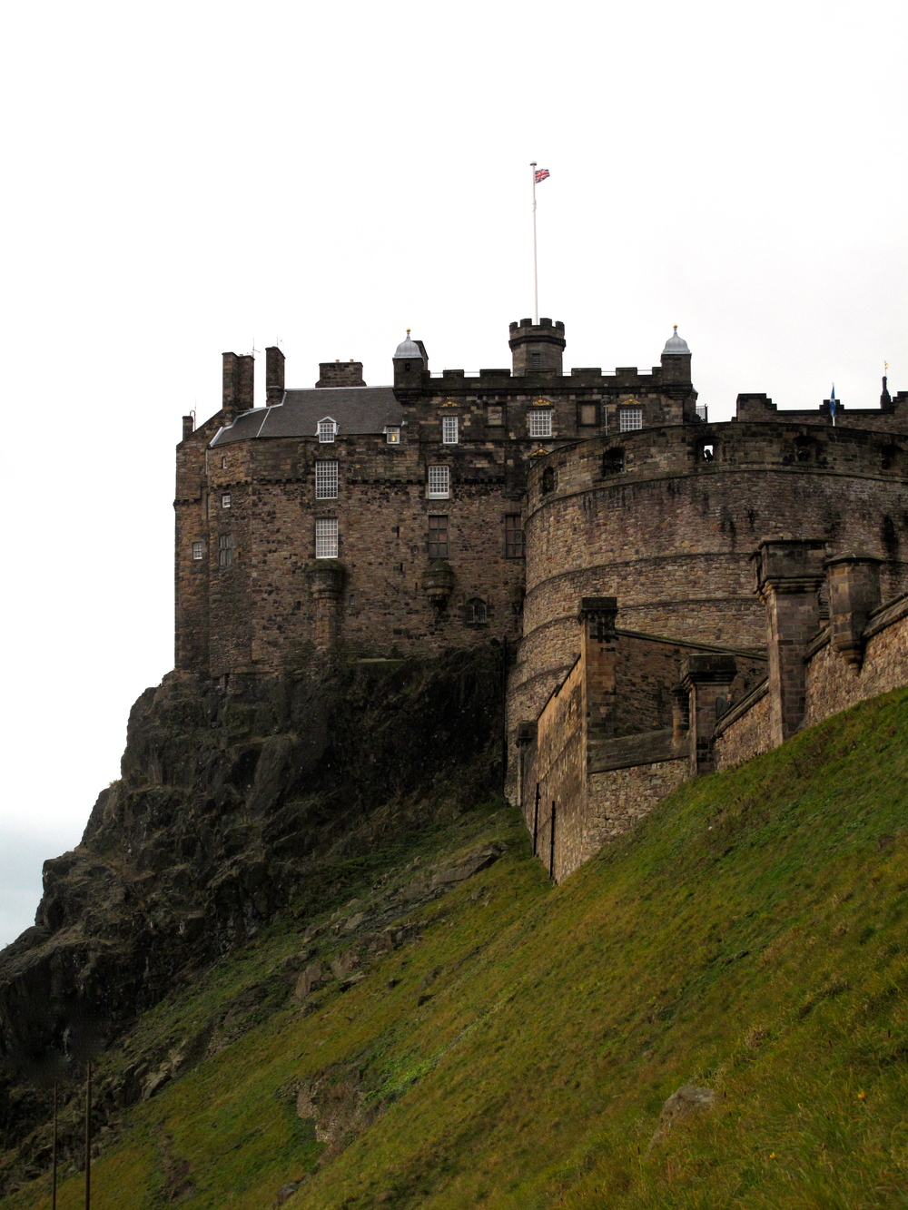 Edinburgh Castle, on a green hill top.