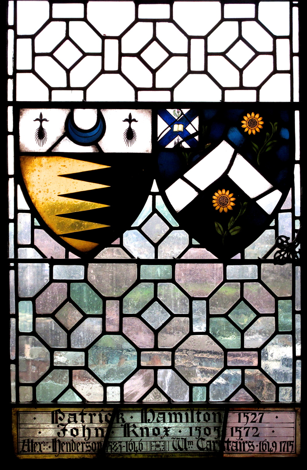 Stained glass patterns and knights coats of arms