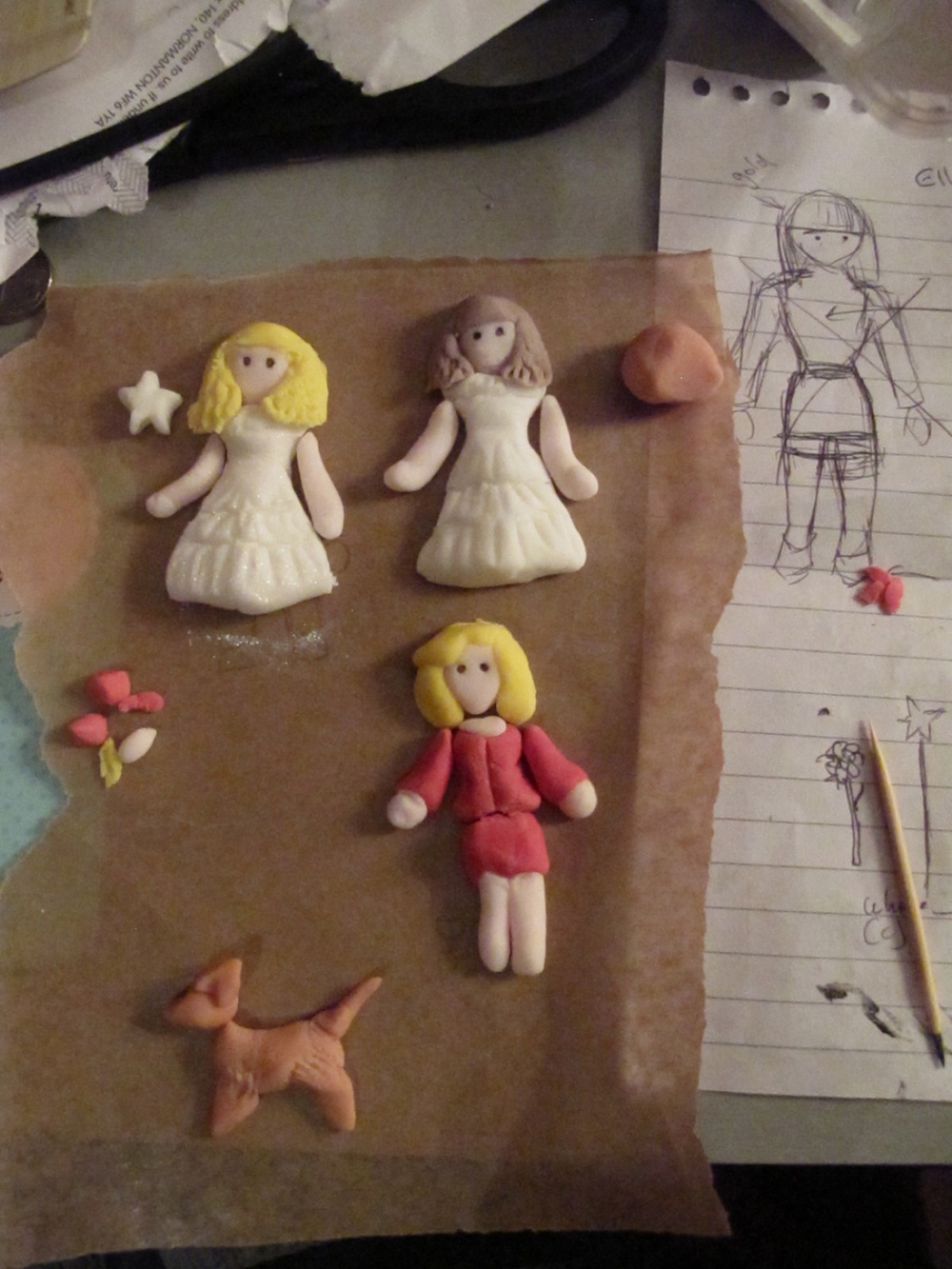Musical characters made from icing - Elle Woods, and Glinda.