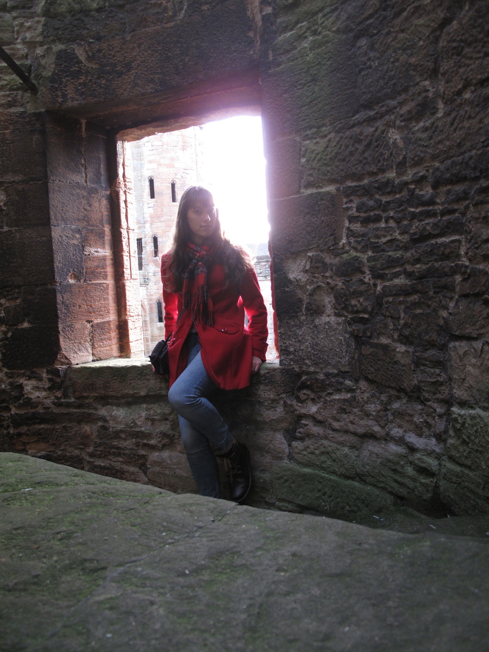 Sitting on a window in the castle tower.