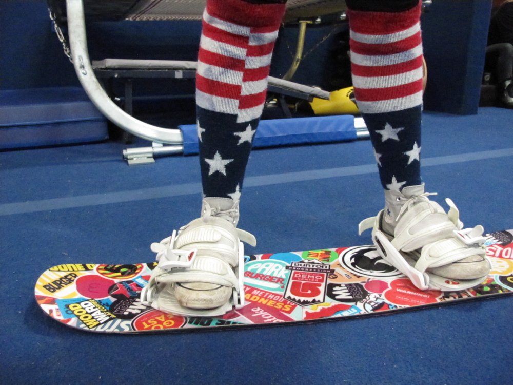 American flag snowboard socks and a practice board at Woodward.