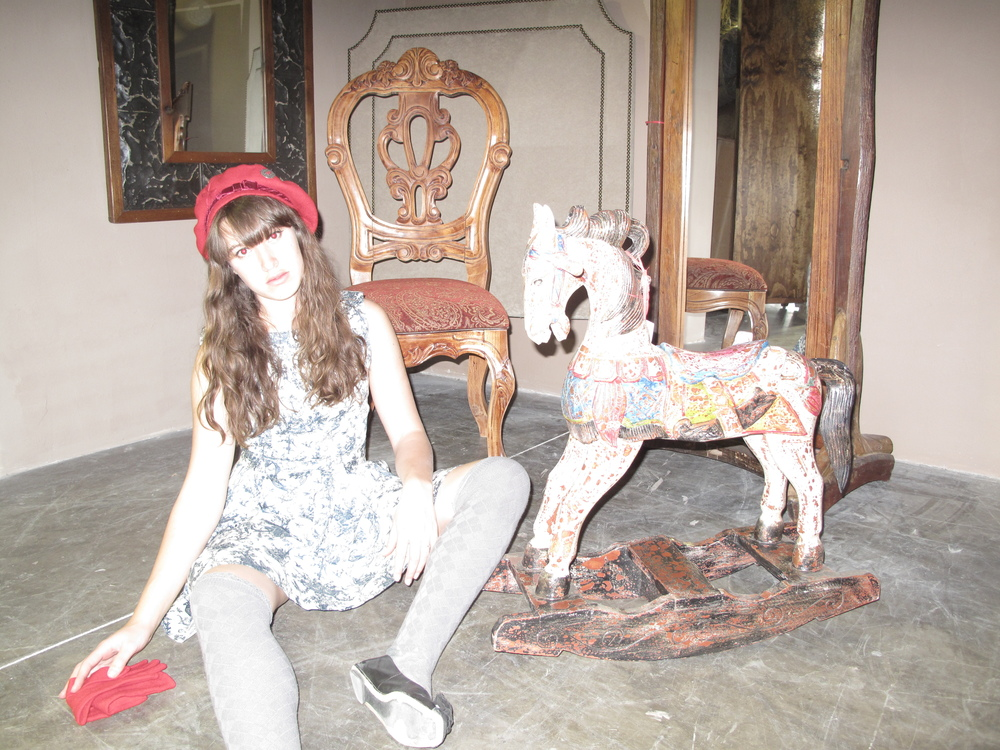 Broken French doll photoshoot, with a rocking horse and french chair.