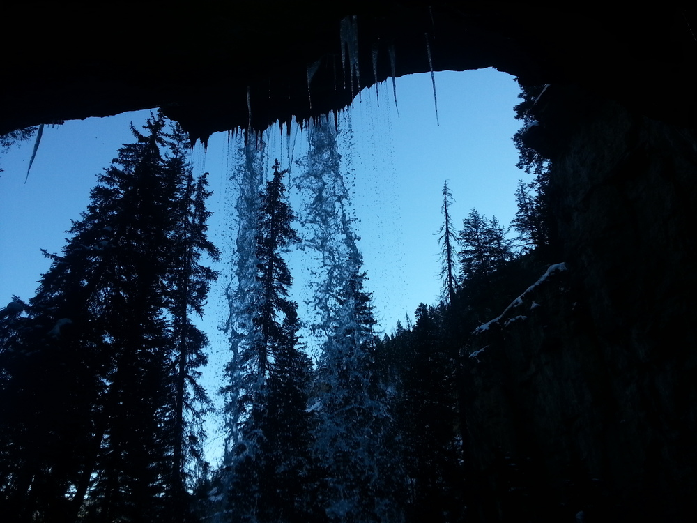 Waterfall at Hanging Lake in the winter - inside the cave behind the waterfall.
