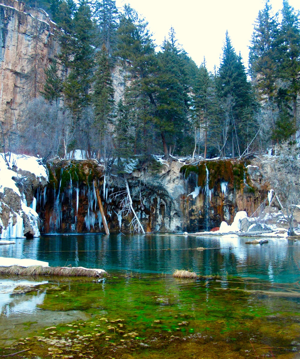 Hanging Lake in the winter - with spectacular colours in the water, and snow.