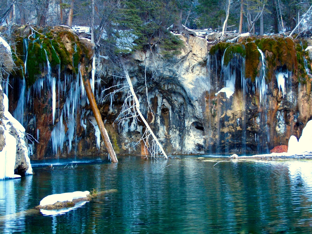 Hanging lake waterfall in winter - all frozen up with icicles.