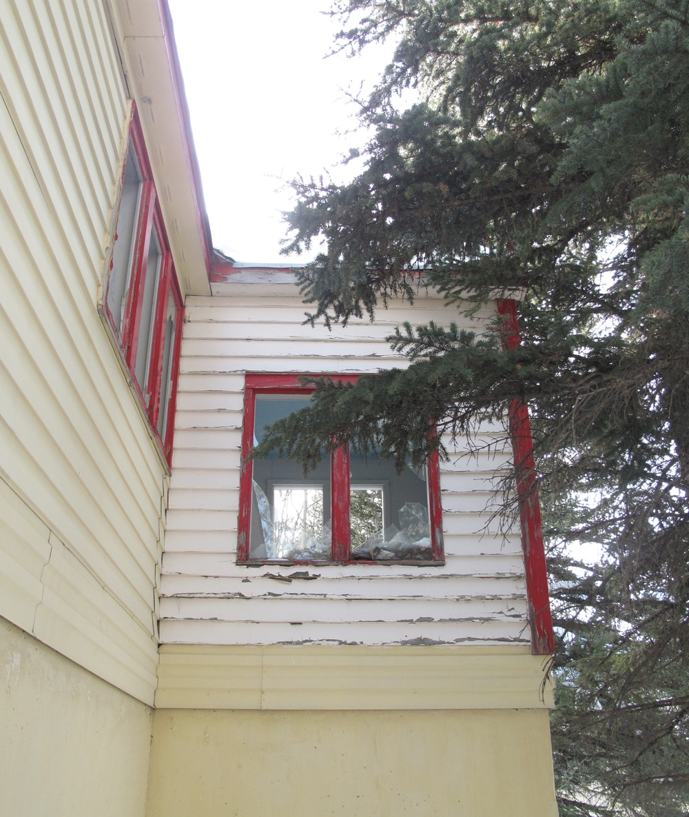 Red and white weatherboard house, Gilman CO in the winter.