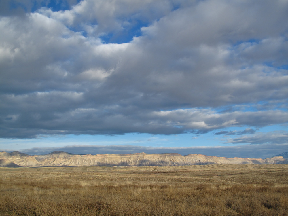 Wheat fields and flat topped mountains near Grand Junction, CO.