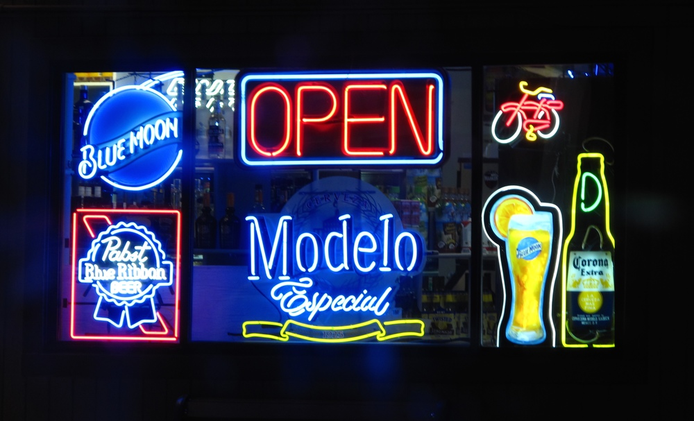 Liquor store neon signs - corona, pabst and blue moon.