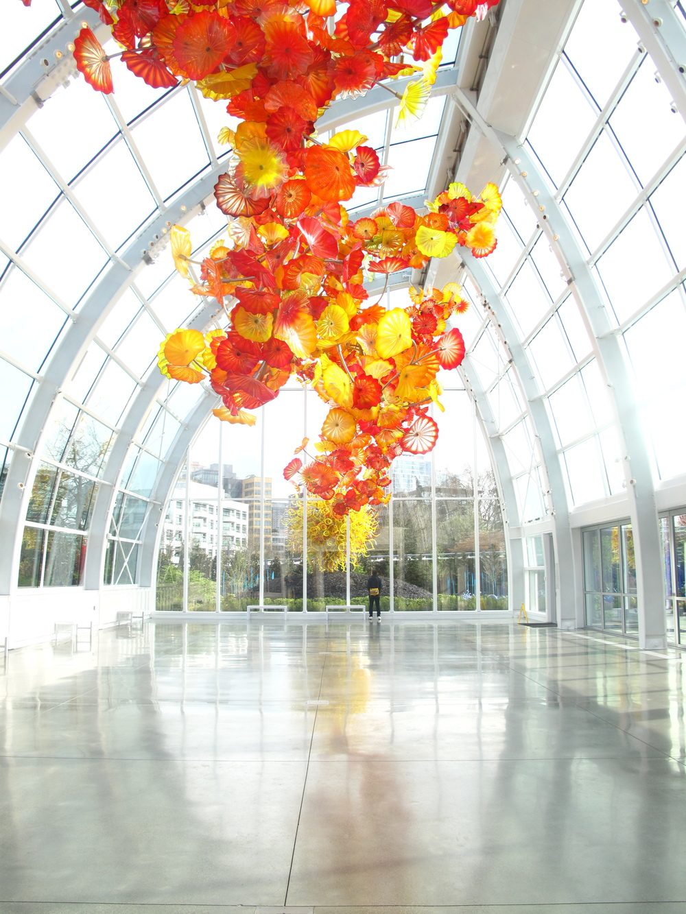 Glass art flowers in the glasshouse at Chihuly Museum.