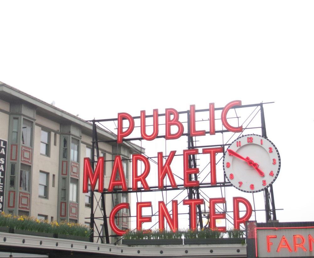 Pike Place Market sign in neon letters, Seattle.
