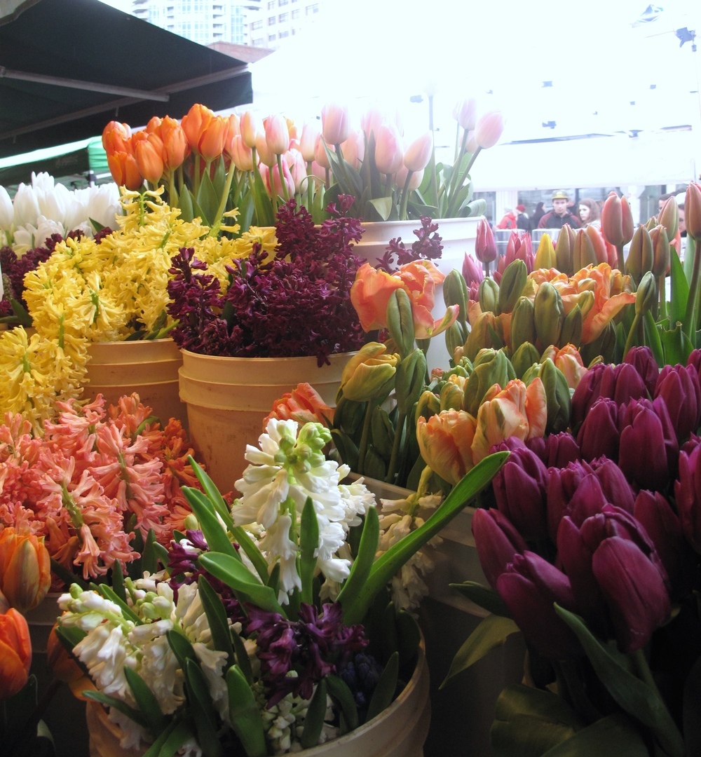 Flowers in buckets - tulips and spring flowers, Pike Place Market, Seattle.