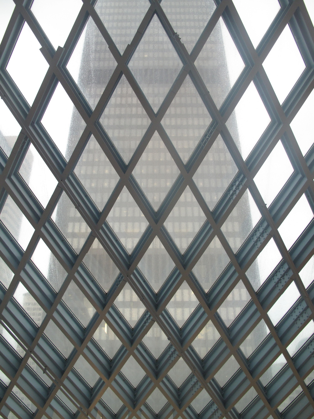 View of a sky rise building from the Seattle Public Library - interesting windows.