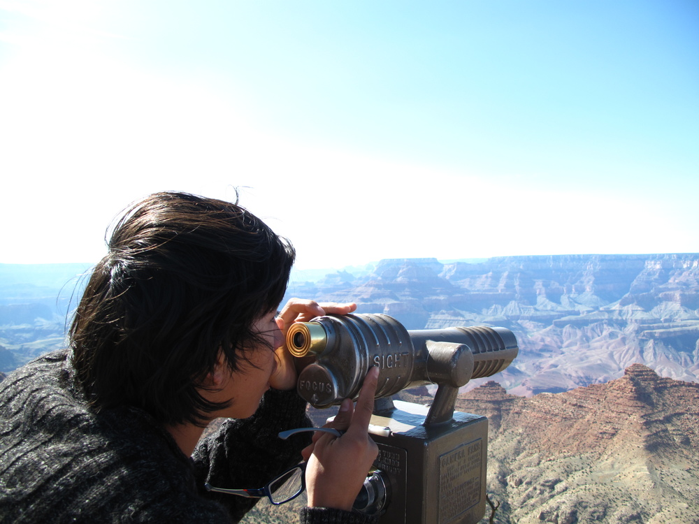 Oliver looking through a telescope at the Grand Canyon.
