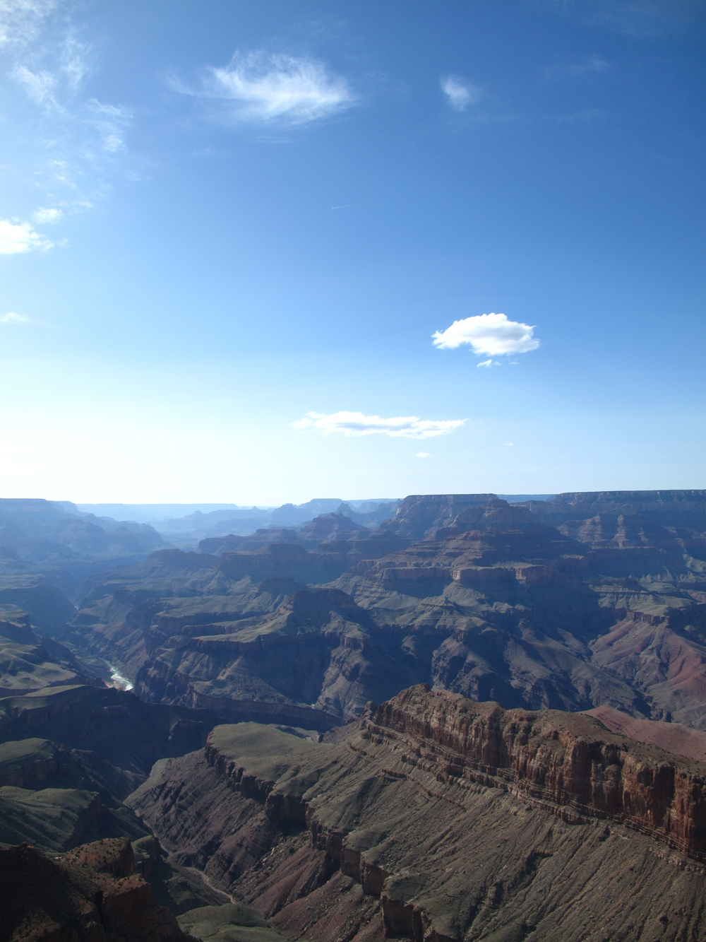 The Grand Canyon in the late afternoon - blue skies and shadows.