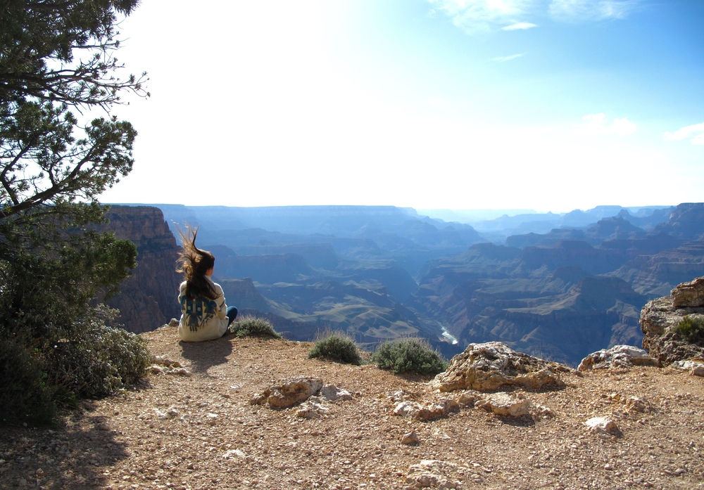 Sitting on the edge of the Grand Canyon.