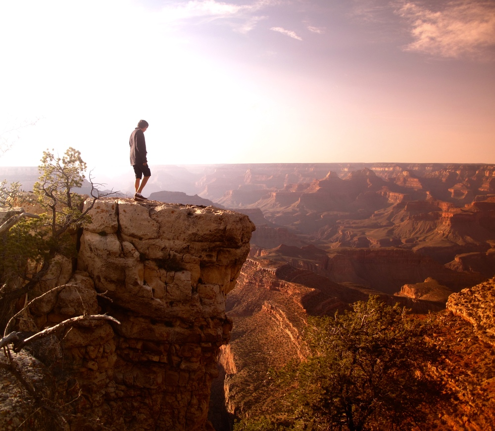 Oliver standing on a pinnacle at the Grand Canyon.