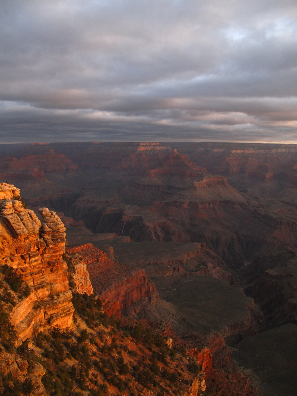 Red walls of the Grand Canyon at sunset.