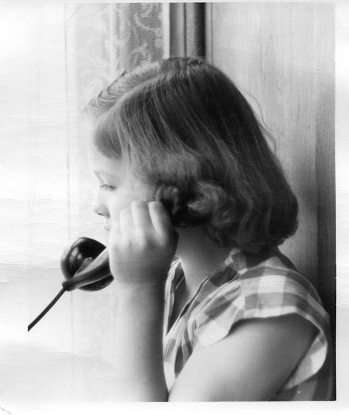 My grandma Eugenie, on the phone as a child.