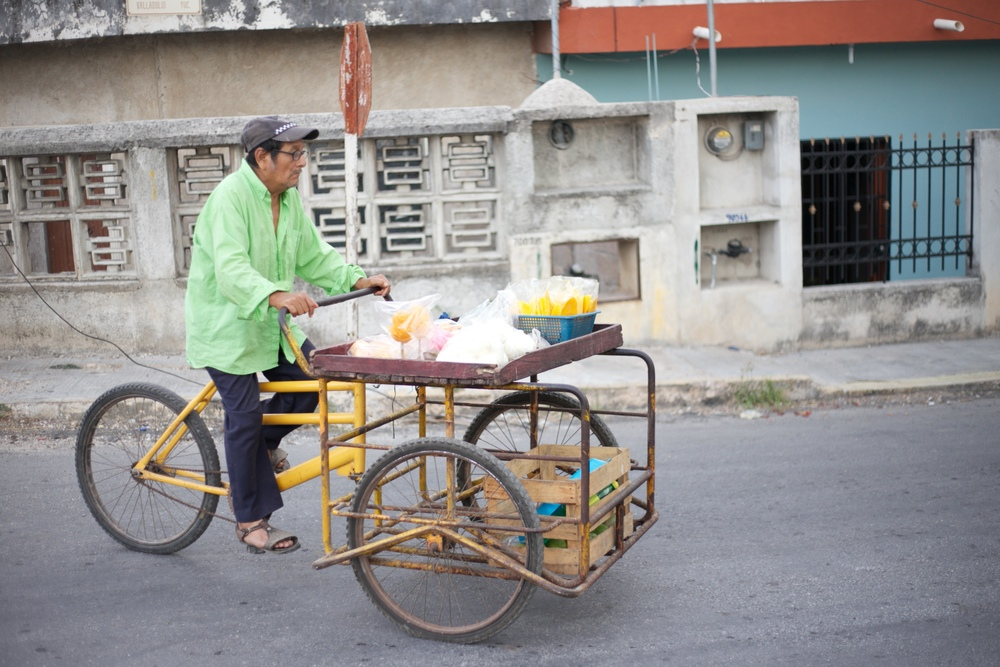 A mango seller on a bicycle in Mexico.