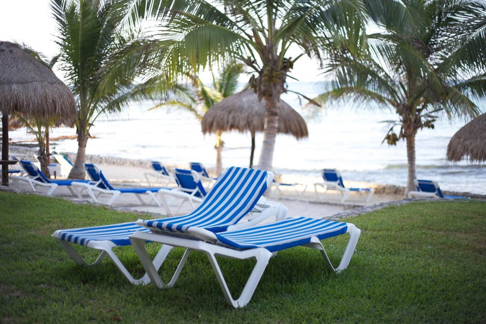 Striped blue and white beach chairs in Akumal, Mexico.