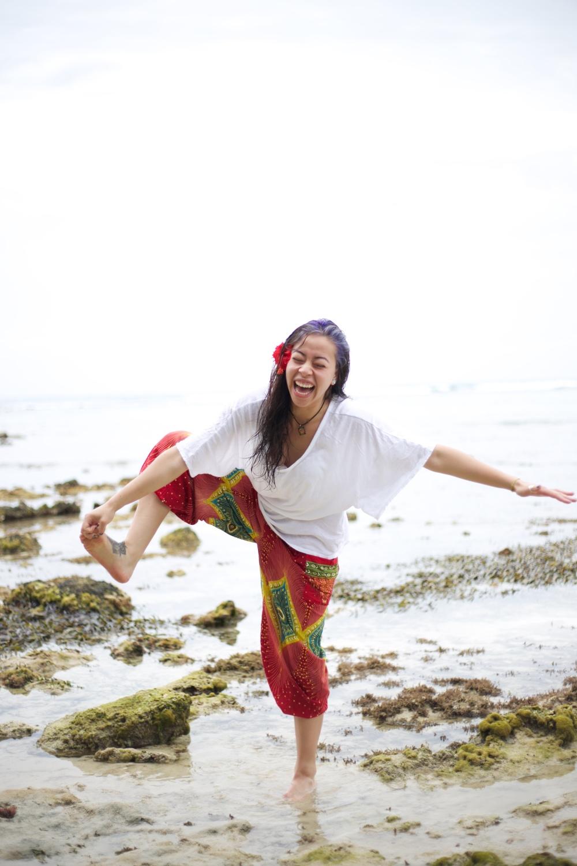 Brenda laughing and losing her yoga pose.