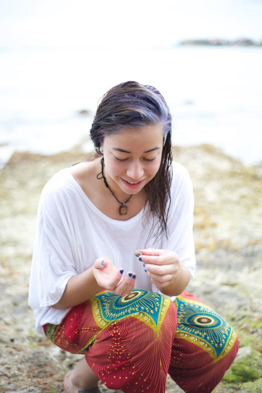 Brenda inspecting a seashell.
