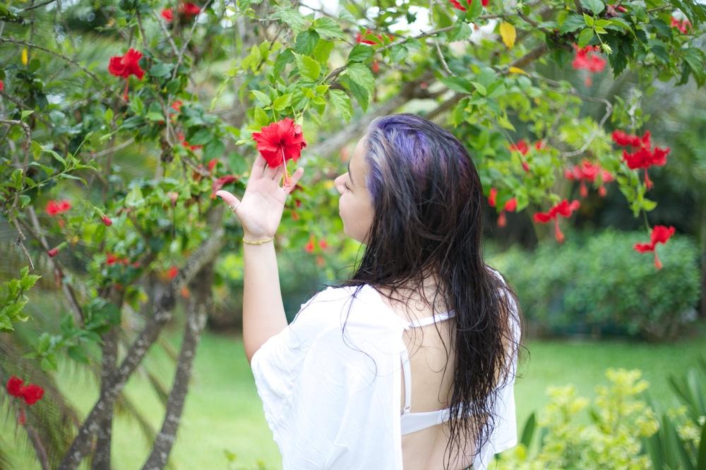 Brenda admiring a hibiscus flower.