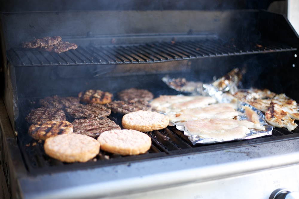 Burgers cooking on the grill.