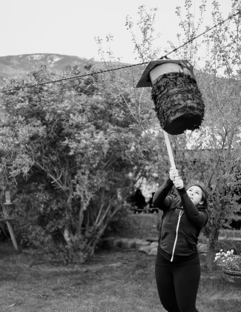 Jessenia breaking the piñata.